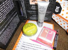 Ipsy August 2014. The lip balm melted but I was SO excited to be getting the green apple instead of the grape that was shown in my Glam Room. The tip of the eyeliner also melted against the cap. The star is the thing I wanted the most, the Urban Decay Perversion mascara. The blush samples are pretty but I'm not a fan of Coastal Scents. The bag is really cute. Rating: A.