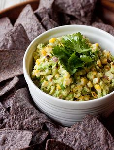Grilled corn guacamole - Dip your chips into this slightly smoky and totally delicious twist on everyone's favorite party dip. | smells-like-home.com