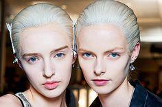 For the Alexander McQueen show, colourist extraordinaire Josh Wood bleached 40 wigs then toned them with various oyster pink and grey tints......gives an Alien like effect!