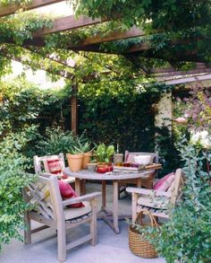 I can't get over how beautiful patios look that are surrounded by plants...it's like your own mini secret garden