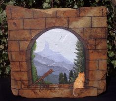 Gaze through this tower's window & you'll see a mystical castle in the distance, shrouded in mist like a dream…. An original OOAK design, hand painted in realistic detail on natural flagstone. Sealed against the weather for display anywhere in your home or garden. Rock stands 6.5″ tall x 7″ wide x 2″ thick.