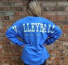 Volleyball Spirit Jersey customized with your color choice! Text reads VOLLEYBALL with Bump Set Spike underneath with a small volleyball on the