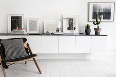 Sitting room storage and display in a crisp black and white Swedish home