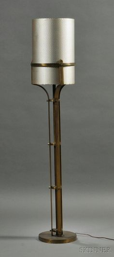 Art Deco Floor Lamp with Aluminum Shade c. 1940s Brass-plated metal stem rising from a circular base with single light fixture, in an industrial style, supporting the shade constructed from a sheet of punched aluminum, two screw caps missing, ht. 62 1/2 in.