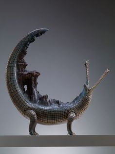 Wang Ruilin sculptures. Amazing, especially the animals carrying worlds on their backs.