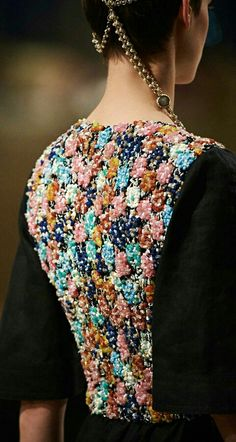 Chanel Cruise 2015 * looked from afar, it makes me imagine flowers tattooed on her body and black fabric wraps outside