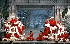 """""""White Christmas"""" movie house -  show finale snow  -I always love that moment when they reach the finale, opening the doors to reveal the snow outside. Is this movie one of your holiday favorites, too? :-)  Julia from Hooked on Houses, pinned 12-25-2015."""