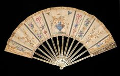 Fan Date: first quarter 19th century Culture: French Medium: Ivory, metallic, mineral, mother-of-pearl, silk, straw, sequins Credit Line: Brooklyn Museum Costume Collection at The Metropolitan Museum of Art, Gift of the Brooklyn Museum, 2009; Museum Collection Fund and the Dick S. Ramsay Fund, 1952