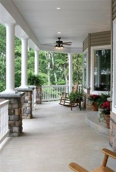 Love wrap around porches-when I buy a house it must have one with a porch rocker.