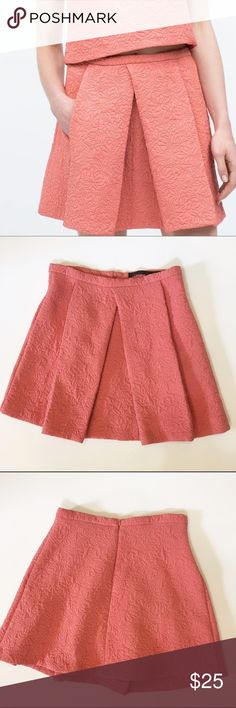 "Zara quilted mini skirt Zara Trafaluc quilted pleated mini skirt. Color is a salmon/ coral. Unlined. Hidden back zipper. Approx measurements laying flat: waist - 12.5"", length- 15.5"". Excellent condition Zara Skirts Mini"