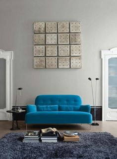 ligne roset ruche chair in green perhaps with wood legs. Black Bedroom Furniture Sets. Home Design Ideas