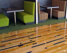 Re-purposed reclaimed original patina gym floor, relaid in random pattern