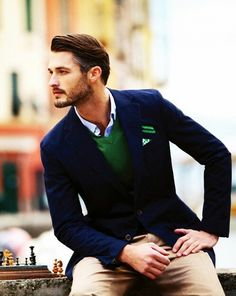A very dapper style look. Here is how: navy blazer, khaki slim leg pants, green Vneck sweater, blue or white shirt and a piece of fabric for a pocket square. Sharp Dressed Man, Well Dressed Men, Fashion Mode, Look Fashion, Mens Fashion, Fashion Trends, Fashion Updates, Suit Fashion, Fashion Spring