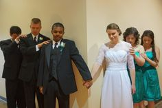 Pre Wedding Prayer---love how the bridesmaids and groomsmen are join them in the prayer