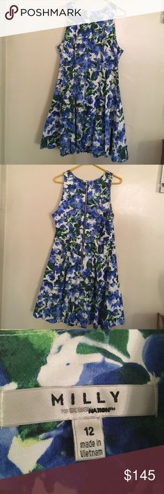 Milly for design nation dress. Super cute floral dress. Perfect condition except a very small I think sweat stain on the back next to the zipper but it almost looks like it's a part of the dress because there are no sweat stains on the collar or pit area. Otherwise it's in perfect condition, no stains, tears, holes, or piling. Make an offer, all reasonable offers accepted, no low balling❤️ 😊 Milly Dresses