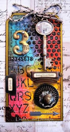 FRIENDS in ART Stay Curious Tag with @Tim Holtz and Ranger Ink products.