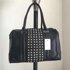 """‼️6HR SALE‼️ black bowler Handbag   """"Black Bowler"""" BrAnD nEw HaNdBag~ ONLY 1 of this color and style available! -Brand: sold by Cali&Karma (retails for $90) -Color: black with gold hardware & rhinestones -Dimensions: 12"""" length, 8"""" height, 5"""" width -Options: adjustable crossbody strap -Details: interior pocket, two interior pouches, **varied lighting may vary bag's appearance -Other: no trades or holds/cannot be restocked/open to •o f f e r s• using offer button/ can provide add'l pics or…"""