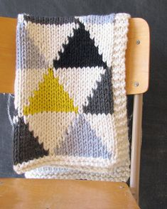 Triangle Baby Blanket Pattern. Knit using a simple Intarsia method it is easy to up size.Great in a monochrome color scheme or choose your own color palette and use up all those bits and pieces in your yarn stash! #etsy #ad #pattern #knitting