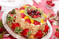Lovely Vanilla cake decorated with fruit.  So summer, so colorful on the table.  Use the Vanilla cupcake recipe from Palm Beach Entertaining (P40), and decorate with fresh, seasonal fruit.