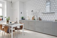 Beautiful, simple and elegant kitchen with grey, white, brown and brass.
