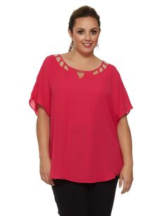 Brighten up your day in this soft, relaxed fit magenta top. The neckline features a cut-out design.
