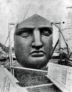 The face of the Statue of Liberty - she does not look like she's messing around! Can you caption the photo?