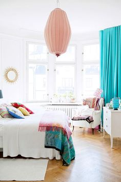 white bedroom with pops of color