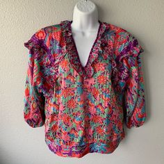 Gently used, no holes or stains!  100% polyester.  Shoulder pads.  Ruffle detail along neckline.  Cropped sleeves. Meant to be one size, I'm a 6 in tops for reference. Price: 40.0 Size M listed by sparky1887