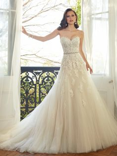 Sophia Tolli - Y11552 – Prinia -     Sweetheart tulle wedding gown with chapel train, this season, lace reveals its sexier side in Prinia. This A-line gown of misty tulle features layers of decadent hand-beaded lace appliqués that trim the strapless sweetheart neckline and adorn a flattering bodice featuring a dazzling crystal hand-beaded belt that emphasizes the waist. Completing this stunner is a back corset and chapel length train. Removable spaghetti and halter straps included. Also…