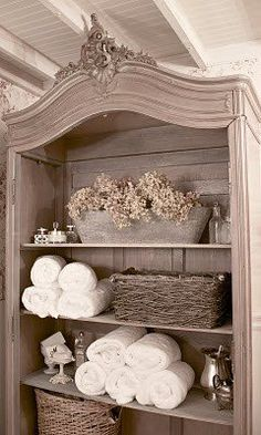 Pretty:  dried hydrangeas, grapevine baskets, silver dishes, white towels make for a beautiful combination!!  (For full guest bath beside stairwell!!)