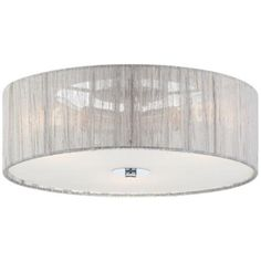 A modern flushmount ceiling light with ethereal gauzy silver fabric. So pretty for a master bedroom.
