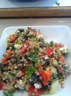This is a great twist on tabbouleh.  Use 2 cups of pearl cous cous and toss with lemon juice, olive oil, good salt, chopped parsley, sliced green onion, seeded and cored cucumber and chopped tomato.  It's delicious.  Add crumbled goat cheese