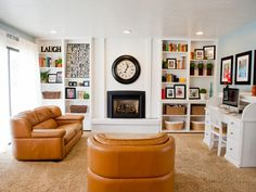 Simple, white built-ins around fireplace. Camel leather sofa and chair.