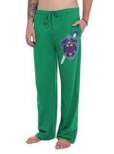 Comfy green guys pajama pants with The Legend Of Zelda shield and sword design on the left leg and an elastic drawstring waist with single button fly.