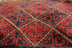 Kyrgyz women make felt carpets with very distinctive traditional patterns that represent subjects of daily life and nature like people, birds, goats flowers etc. They make the felt in summer and sew the carpets during the long cold winters.