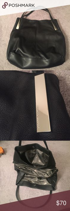 Vince Camuto black leather handbag Vince Camuto Black leather handbag. Three sections with middle zippered section. Multiple interior pockets. No exterior wear-like new Vince Camuto Bags Shoulder Bags