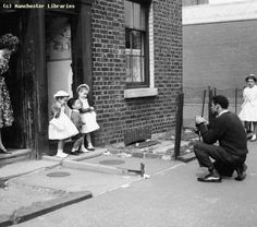 Children and photographer, Embden Street, Hulme, 1962 by mcrarchives, via Flickr