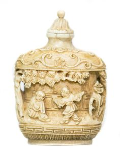 CHINESE CARVED IVORY SNUFF BOTTLE Early 20th Century. Of square rounded form, carved in relief depicting interior scenes within trees, with...