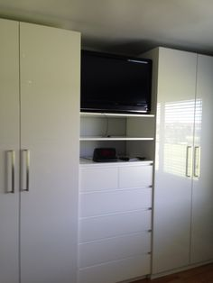 Great use of the PAX system from IKEA. We put an IKEA chest of drawers between 2 of the systems and added shelves above for the TV and books. Incredible amount of closet space. We added LED lights inside the wardrobes.