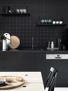 black kitchen with wood accents // anne sage