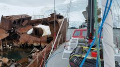 Moored up to old whale processing ship at Enterprise Is.  Ship went on fire in the 1930s and the captain grounded it.  Several old steam winches were visible in the hull.  Getting on and off this mooring took putting 2-3 people scampering on the hulk.