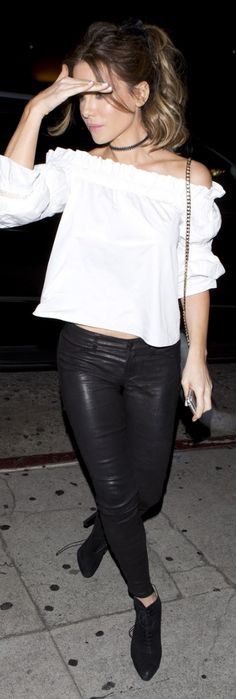 Who made Kate Beckinsale's white off the shoulder top, black leather pants, suede lace up boots, and gray handbag?