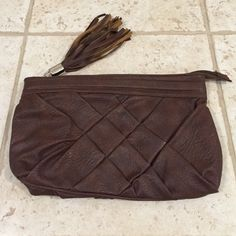 Brown clutch Brown clutch, same pattern on the front and the back Bags Clutches & Wristlets