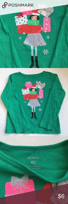 Carter's Toddler Girl Christmas Tee Carter's toddler girl Christmas tee- size 4T. Great condition. Really cute top-- a glittery sparkle on the presents, snowflakes and the girl's skirt make makes this extra fun to wear! Looks super cute with hot pink pants-- ***see my other listing for those, or a pair of denim jeggings!*** Carter's Shirts & Tops Tees - Long Sleeve