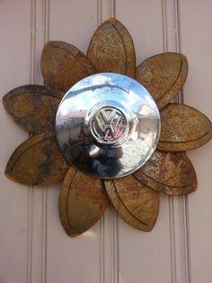 yard art with old hub caps | Rusted metal VW flower wall hanger by MyRustedRoots on Etsy