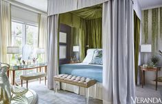 The master bedroom of a Dallas townhouse by designerJan Showersfeaturesa canopy bed with parrot-green silk interior. The tufted bench isin an Ashley Studio Ultrasuede,the lamp is from theJan Showers Collection,the 1940s French mirrored dressing table,bench andrug are byJan Showers for Moattar.