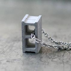 """Max Steiner's Cement Cinder Block Necklaces are actually cast from poured concrete and cured for a month before being sold. At 3/4"""" tall, they're the cutest construction materials with which you can adorn yourself. — boingboing.net"""