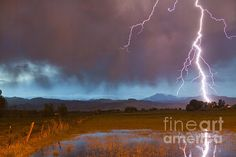 Lightning bolts, cloud to ground striking the front range foothills of the Colorado Rocky Mountains in Boulder County. Fine art photography prints, decorative canvas prints, acrylic prints, metal Prints wall art  for sale on FineArtAmerica.com. Prints starting at $25. Copyright: James Bo Insogna
