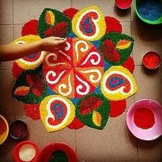 View top-quality stock photos of A Hand Finishing A Rangoli. Find premium, high-resolution stock photography at Getty Images. Rangoli Designs Flower, Rangoli Ideas, Rangoli Designs Diwali, Rangoli Designs Images, Diwali Rangoli, Flower Rangoli, Beautiful Rangoli Designs, Dot Rangoli, Henna Designs
