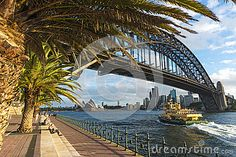 The ferry leaving Luna park on a winters afternoon heading for Circular Quay with the bridge and Opera House in background. Copyspace.